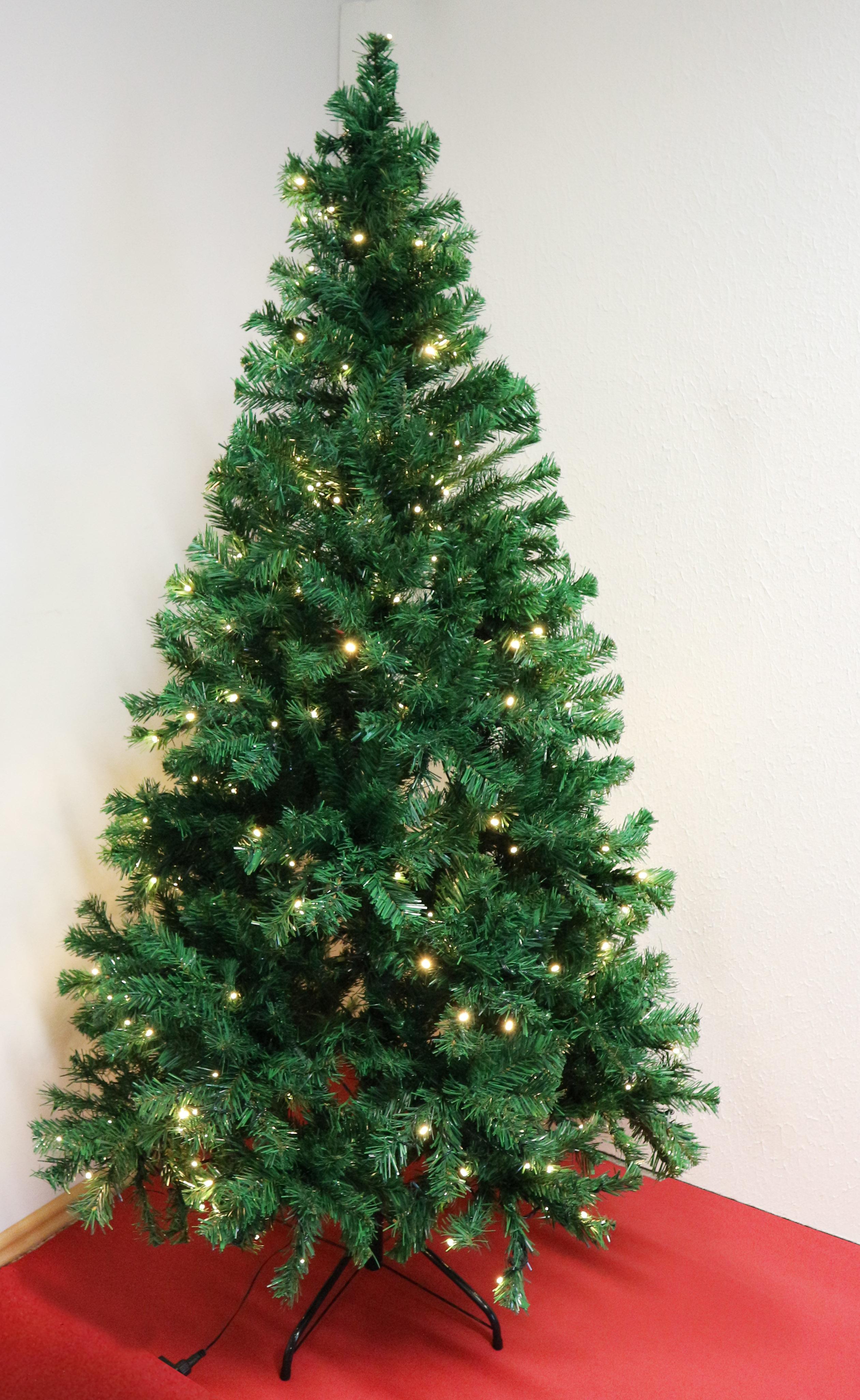 Weihnachtsbaum mit Ständer und Lichterkette